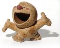 Figurine Migou content